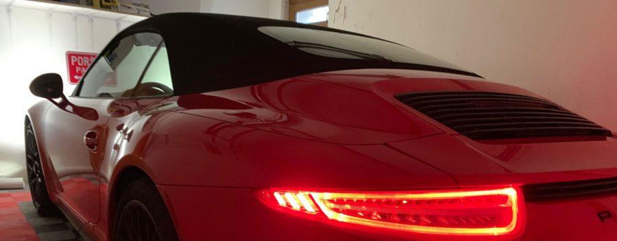 porsche rouge assure stocker garage bann
